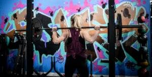 A photo of a woman working out with a barbell