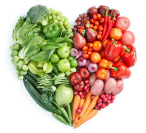A heart photo made up of fruits and vegetables.