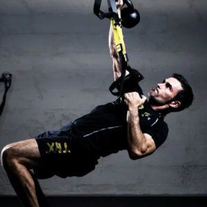 Photo of a man doing suspension training